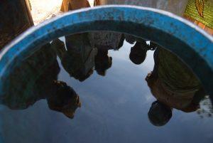 Reflection in water tank. Ghana. Photo: © Arne Hoel / World Bank